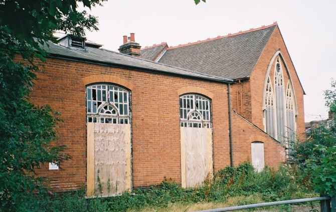 Ipswich Historic Churches Trust strikes again. Boarded up St Michael, its parish rooms to the left.