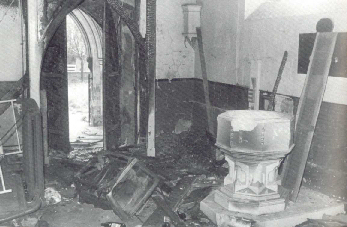 The interior gutted by fire in 1977, shortly before demolition.