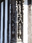 cornerpost of the guildhall - spot the unrestored carving