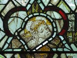east window glass: crucified Christ (English medieval)