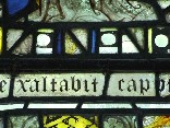 east window glass: exaltabit caput